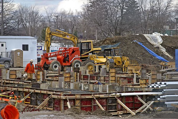 Concrete construction: Simpson concrete formwork system wall panels in place for cast-in-place basement/ foundation walls. Panels consist of coated plyform on steel frames, connected by pin system, supported by Simpson brace hardware mounted pm 2 inch dimension lumber. YMCA, Ann Arbor, 2003.