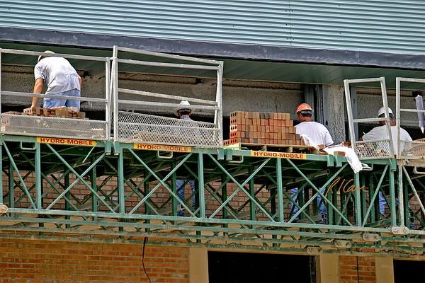Masonry Construction: brick, concrete block, mason, scaffold, mortar, mix, shore, clean, saw