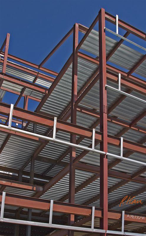 Steel Construction: Bolted steel structural frame of steel wide flange columns, girders. Corrugated galvanized steel decking provides support for concrete slab floor. Ann Arbor, 2005.