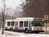 Municipal bus: Ann Arbor bus, The Ride, travels south on Glacier Way in a snow storm, to stop at the VA Hospital and then go downtown. Ann Arbor, Michigan, 2004.