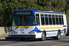 Municipal bus: UCLA Fleet and Transit Services compressed natural gas (CNG) powered bus traveling west on Le Conte, Los Angeles, CA 2004.